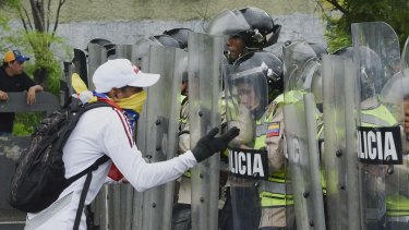 A protester yells at police during an opposition march in Caracas on May 11.