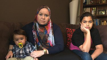 Jennifer Birrell in Melbourne with two of her five children, Ahmed, 1, and Jamilla, 11. Her other three children are in Riyadh.