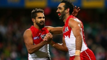 Proud pair: Lewis Jetta and Adam Goodes celebrate a goal against West Coast.