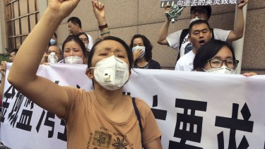 Residents demand compensation for damages to their homes after an explosion at Tianjin Port.