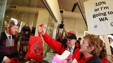 The AEU's Mary Bluett delivers protest postcards to then Premier John Brumby in 2007.
