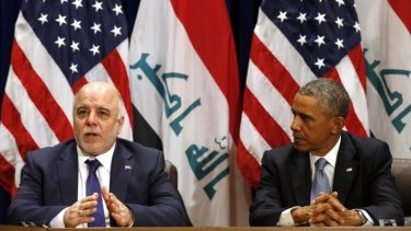"""Confusion: Iraqi PM Haider al-Abadi, left, stunned American reporters by informing them that Iraq had """"credible"""" evidence that the Islamic State planned to bomb New York."""