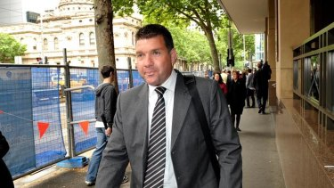 Suspended Victorian Police officer Senior Constable Simon Artz outside the Melbourne Magistrates' Court earlier this month.