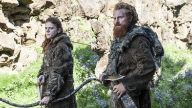 Baying for Crow blood ... Ygritte (Rose Leslie), left, is keen to shoot as many Night's Watch men as possible, including John Snow, while wildling leader Tormund (Kristofer Hivju) cuts down many men before being captured.