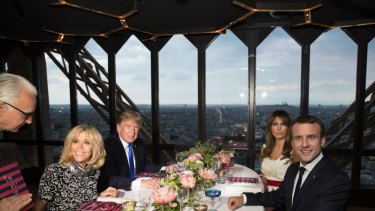 Donald Trump, US first lady Melania Trump, French President Emmanuel Macron his wife Brigitte Macron, sit for dinner at the Jules Verne Restaurant in the Eiffel Tower on Thursday.