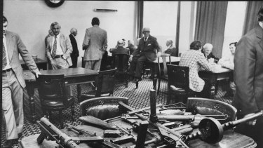 Police use the Victorian Club to display the types of weapons used in the Great Bookie Robbery.