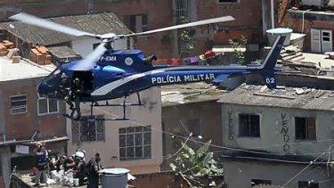 Police arresting gang members in the large Rio de Janeiro slum.