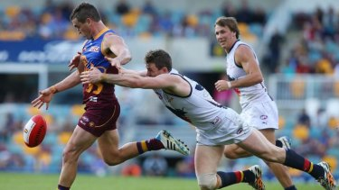 Tom Rockliff (left) says the Lions are hunting a major scalp to show the 105-point thrashing by the Crows was an aberration.