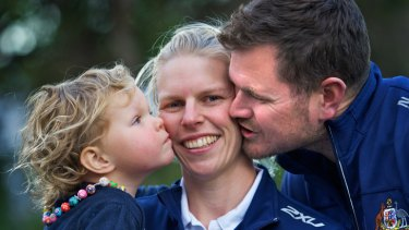 Hurt: Sarah Tait (centre), with husband Bill and daughter Leila, has a forearm injury.
