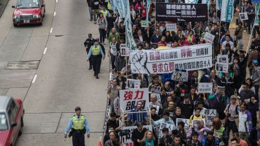 People take part in a rally on January 10 in Hong Kong, protesting the disappearance of five Hong Kong booksellers.