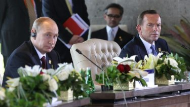 Vladimir Putin and Prime Minister Tony Abbott during the APEC Economic Leaders Meeting.