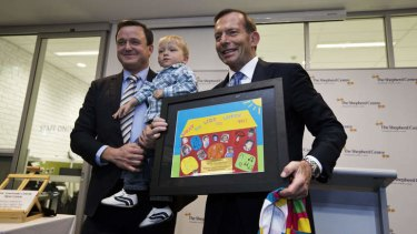 Colourful occasion: Tony Abbott at the opening of a Newton cochlear implant centre.