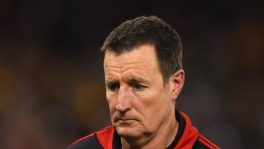 Obliterated: John Worsfold and the Dons copped a hiding on Friday night.