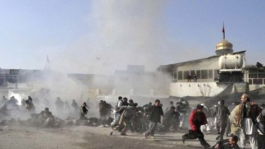 Devastation ... people flee the scene of a suicide bomb in Kabul.