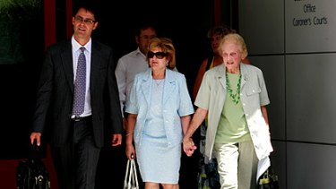 Ann Kramer (centre) leaves the Melbourne Coroner's Court yesterday hand-in-hand with her aunt, Joan Keating, and flanked by lawyer Steve Schembri.