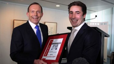 Prime Minister Tony Abbott presents Fairfax journalist Jonathan Swan with the 2014 Wallace Brown Young Achiever Award for press gallery journalism at Parliament House.