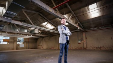 Artbank Director Tony Stephens inspects the artwork-lending agency's new warehouse in Collingwood.