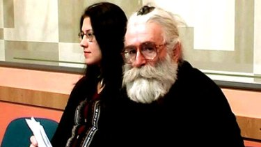 Disguise ... Radovan Karadzic posing as a doctor of alternative medicine called Dr Dragan David Dabic while attending a medical lecture.