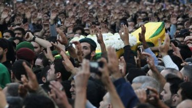 Relatives and Hezbollah members carry the coffin of one of the victims killed during suicide bombings near Iran's embassy compound in Beirut.