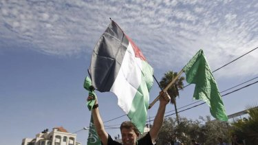 Released prisoner Hamas militant Nael Barghouti waves a green Islamic flag and a Palestinian flag.