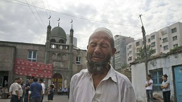 Distraught... a Uighur man reacts to questions about the attacks in Urumqi.