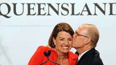 Winner's kiss . . . Ms Bligh with husband Greg Withers and (right) Lawrence Springborg with wife Linda last night.