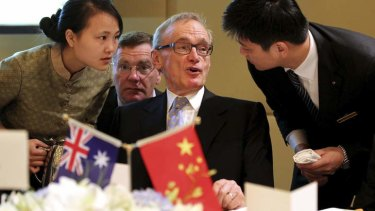 Bob Carr deals with the fine print in Chengdu.