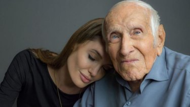 Olympian and former WWII prisoner of war Louis Zamperini became close friends with Angelina Jolie, who is directing <i>Unbroken</i> (the film based on his life) in Australia.