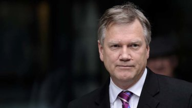 Disbelief ... Andrew Bolt leaves court after losing the case yesterday.