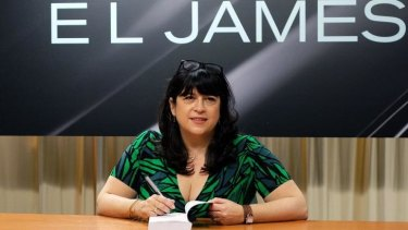 E.L. James signing a copy of her new book <i>Grey: Fifty Shades of Grey as Told by Christian</i> in New York earlier this month.
