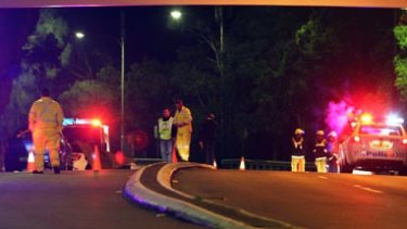 Tragedy … emergency workers at the site of the accident in Linley Point.