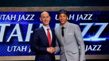 Music to his ears: Utah Jazz draftee Dante Exum with NBA commissioner David Silver.