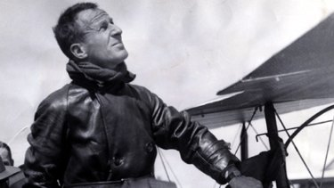 Sir Charles Kingsford Smith climbs out of his Lockheed plane called the 'Lady Southern Cross' at Municipal Airport, California.