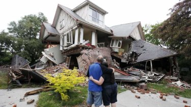 A couple in front of their damaged home in Christchurch after the 2011 earthquake.