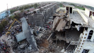 The site where an Indonesian air force cargo plane crashed in Medan, North Sumatra.