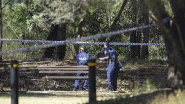 NSW police search the crime scene.