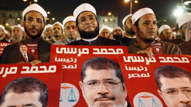 Muslim scholars in Egypt listen to Muslim Brotherhood presidential candidate Mohammed Mursi during a campaign rally in Cairo.