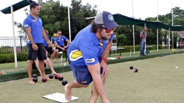On the mark ... Nathan Hindmarsh shows his skills are not only confined to the field yesterday.