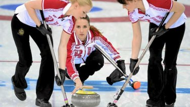 Ice queens: Russia's Anna Sidorova (C) throws the stone as her teammates Ekaterina Galkina (R) and Alexandra Saitova sweep the ice during the Women's Curling.