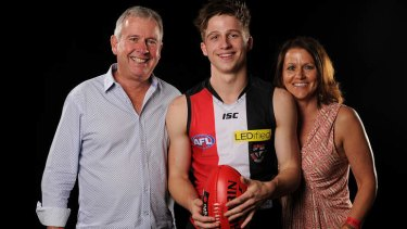 Jack Billings poses for a photograph with his father Graeme and mother Letitia.