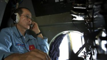 Vietnam air force Colonel Duong Van Lanh looks at the navigation control panel aboard aircraft Antonov An-26 during a search mission for the missing Malaysia Airlines Boeing 777 over water between Malaysia and Vietnam.