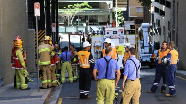 Fire crews at the scene of an electrical fault, which knocked out power to 30 buildings in the Brisbane CBD.