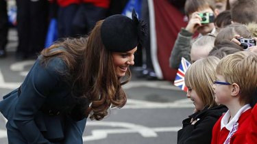 Crowd favourite ... Catherine, Duchess of Cambridge, speaks to school children.