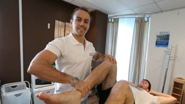 """Hands on: Physiotherapist Troy Wallace's hands are his key """"tool""""."""