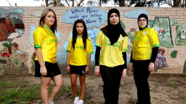 Culture not conflict … members of the Lakembaroos football team, from left Shaza Rifi, Sue Rifi, Malak Farhat and Zeinab Farhat, can play while wearing a hijab - unlike international counterparts.