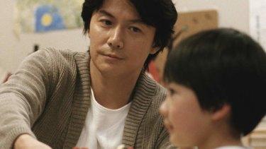 Masaharu Fukuyama as Ryota Nonomiya and Keita Ninomiya as Keita Nonomiya in <i>Like Father, Like Son</i>.