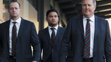 Issac Luke (centre) on his way to Tuesday's judiciary hearing.