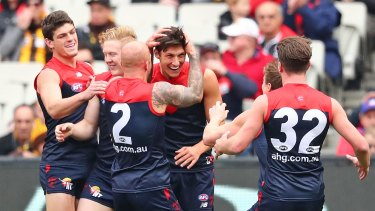 The Demons get around first-gamer Sam Weideman after he kicked a goal with his first kick in the AFL.