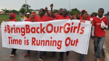 Protesters call on the Nigerian government to rescue the kidnapped girls of the government secondary school in Chibok during a demonstration in Abuja, Nigeria.