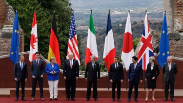 Donald Trump with fellow leaders of the G7 in Sicily at the weekend. The US refused to agree to the position on climate change.